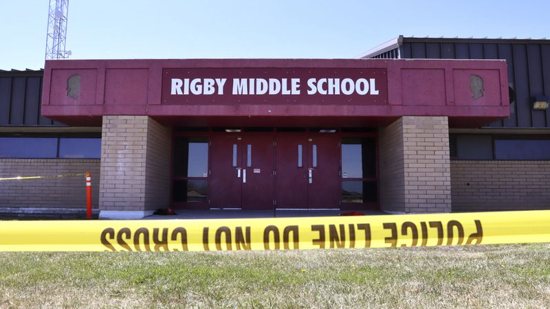 Police tape marks a line outside Rigby Middle School following a shooting there earlier...