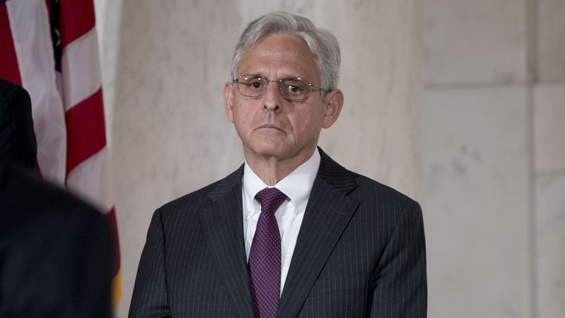 FILE - In this July 22, 2019, file photo, Merrick Garland pays his respects for the late...