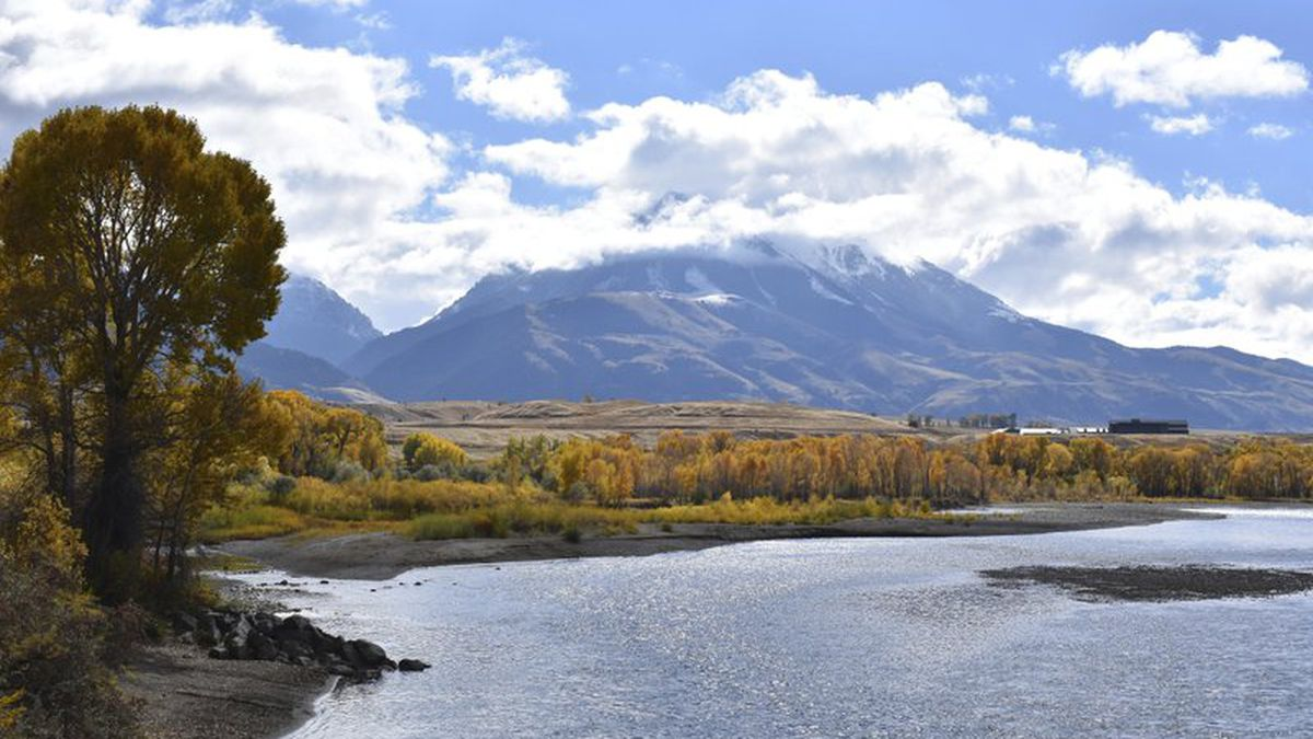 Emigrant Peak is seen rising above the Paradise Valley and the Yellowstone River near Emigrant, Mont.,  (AP Photo/Matthew Brown)