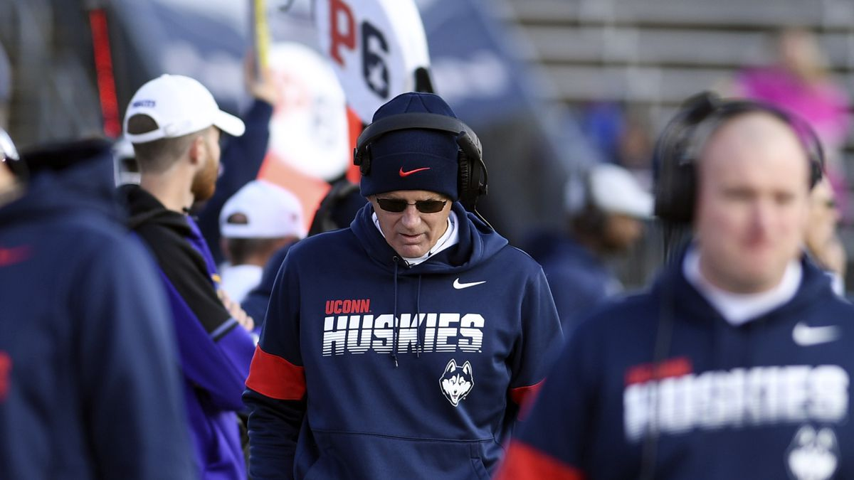 "Connecticut head coach Randy Edsall walks the sidelines during the second half of an NCAA college football game against Connecticut Saturday, Nov. 23, 2019, in East Hartford, Conn. Edsall said of the season cancellation: ""We engaged and listened to the concerns of our football student-athletes and feel this is the best decision for their health, safety, and well-being."""