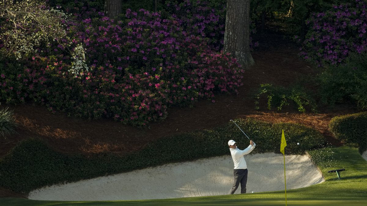 Rory McIlroy, of Northern Ireland, hits from the bunker on the 13th hole during a practice...