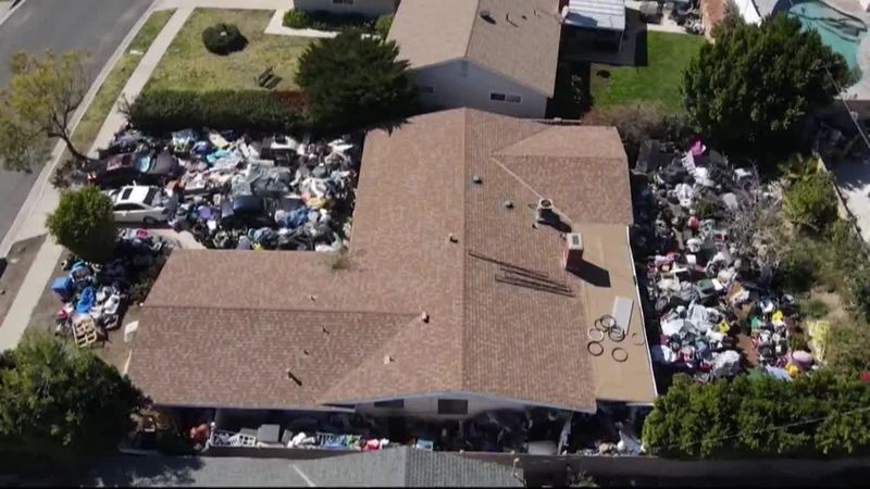 A home in Los Angeles looks like a junkyard, packed with so much stuff. The city is trying to...