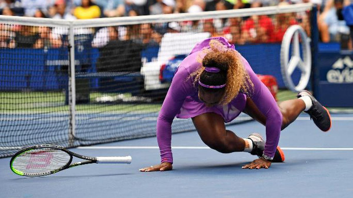 Serena Williams, of the United States, falls while chasing a return to Petra Martic, of Croatia, during round four of the US Open tennis championships Sunday, Sept. 1, 2019, in New York. (AP Photo/Sarah Stier)