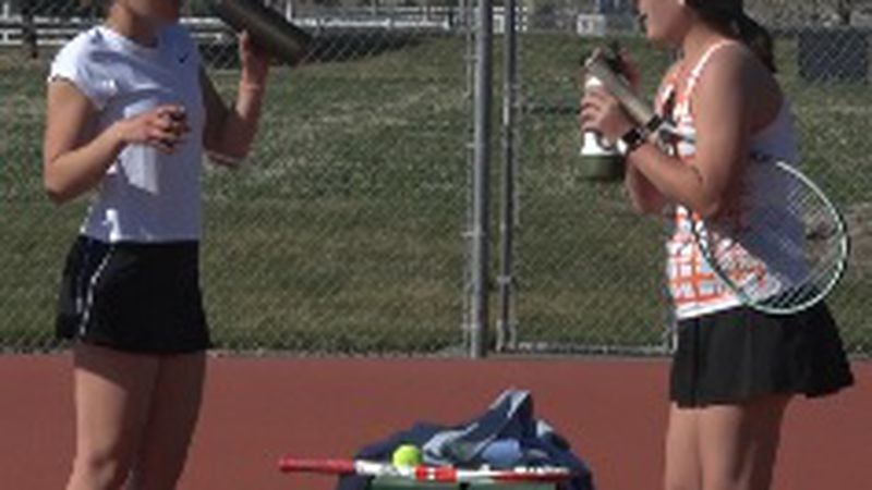 Jerome and Wood River tennis players take a water break in between sets.