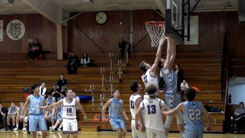 Dietrich's Rhys Dill goes up for the offensive rebound and putback.