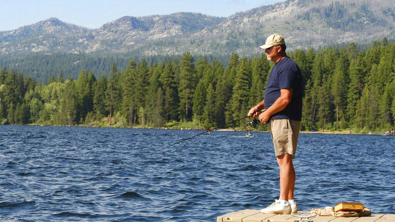 FILE - In this July 7, 2004, file photo, Dennis Rogers, of Corona, Calif., fishes off a dock at...