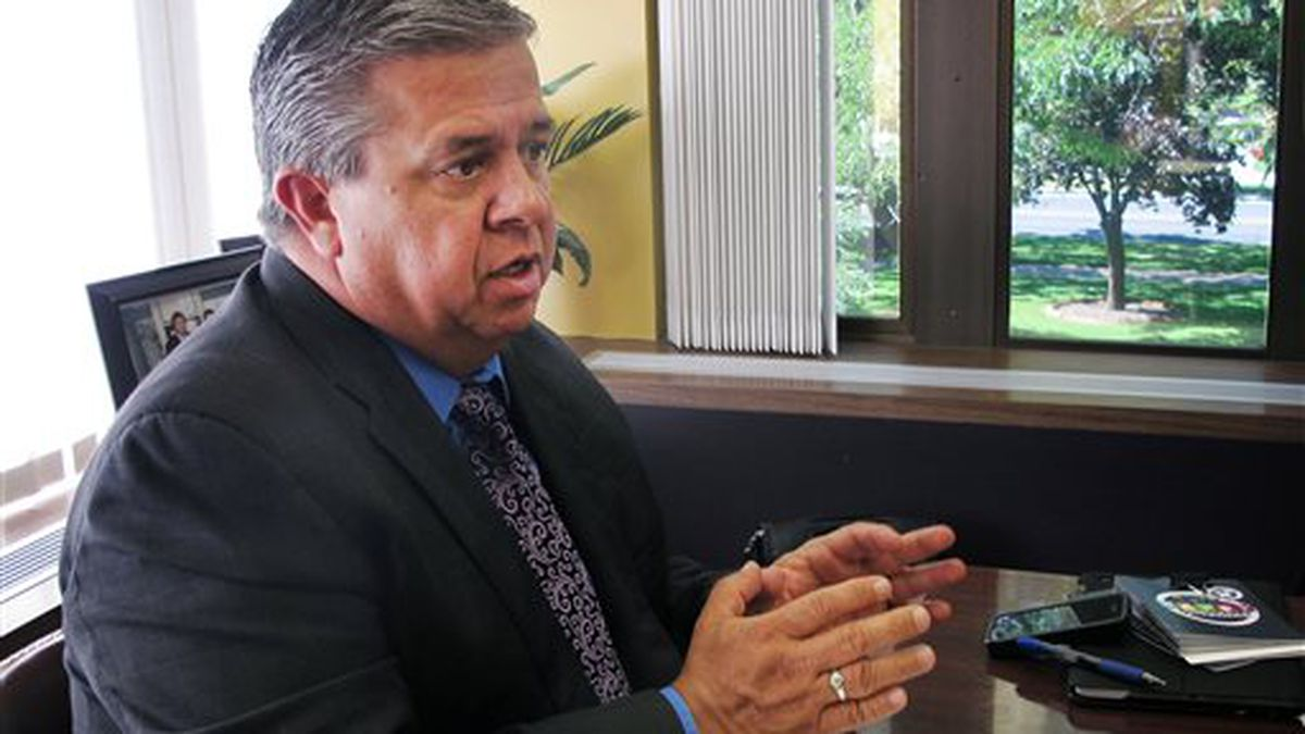 The former Idaho Superintendent of Public Instruction Tom Luna speaks in his office in Boise, Idaho on Tuesday, Sept. 2, 2014. New Idaho GOP Chairman Luna says Republicans in the state have an opportunity to unite by focusing more on what they have in common