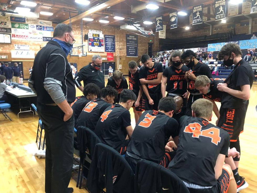 The Tigers try to figure out their game plan in a late game timeout.