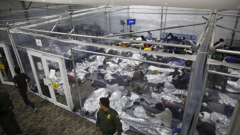 FILE - In this March 30, 2021 file photo, young minors lie inside a pod at the Donna Department...