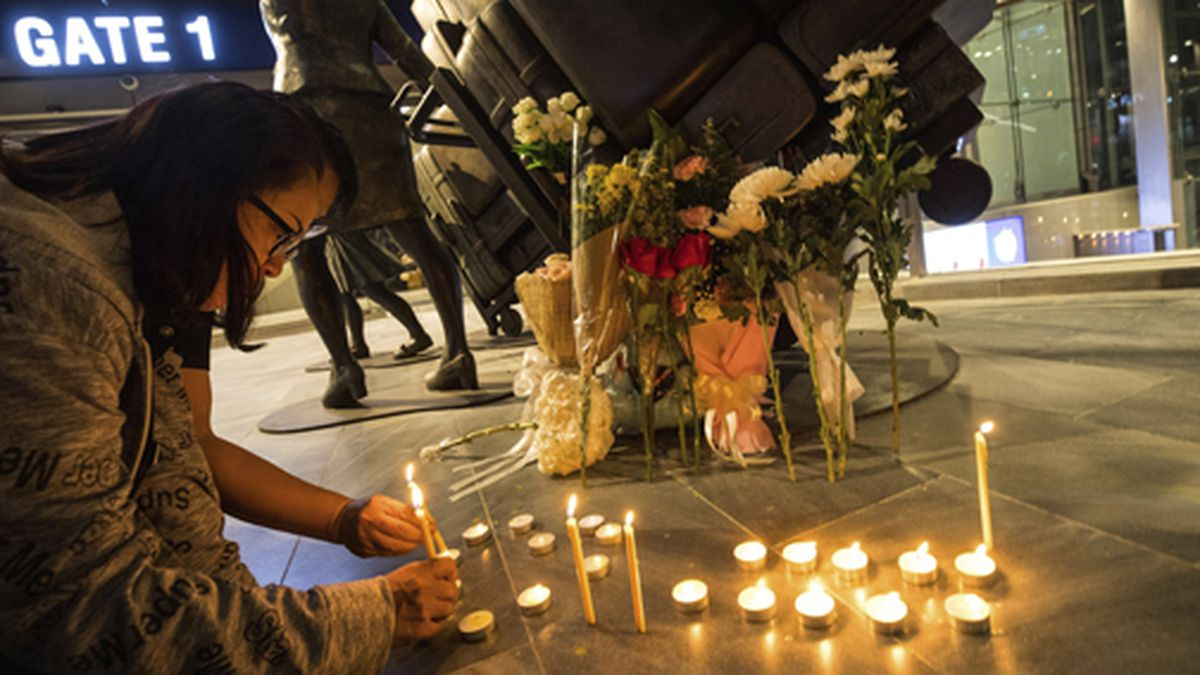 People attend a memorial service at Terminal 21 Korat mall in Nakhon Ratchasima, Thailand,...