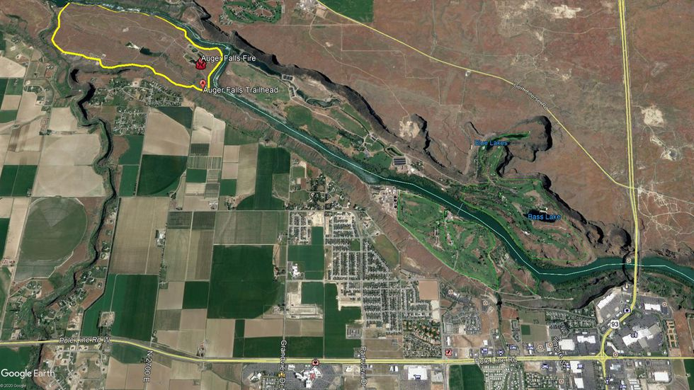 About 5 acres in the Auger Falls Heritage Park was burned Monday afternoon during a brush fire. The yellow area outlines the park area, but the fire only burned in a portion of the recreation area.