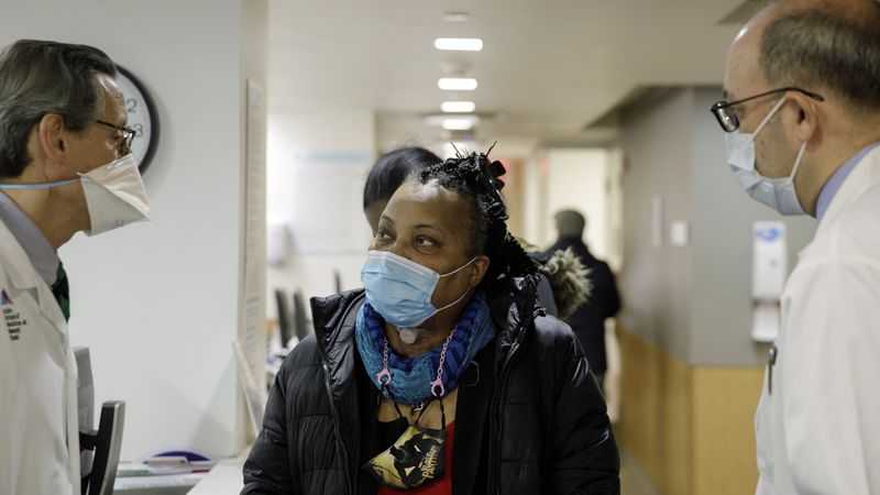 Trachea transplant recipient Sonia Sein talks with the lead surgeon of her procedure, Dr. Eric...