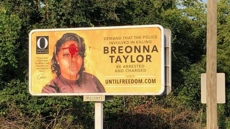 Red paint is now seen splattered across Breonna Taylor's forehead on a billboard in Louisville,...
