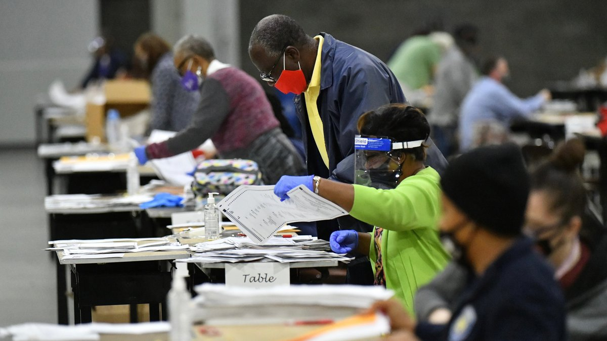 FILE - In this Saturday, Nov. 14, 2020 file photo, election workers in Fulton County began...
