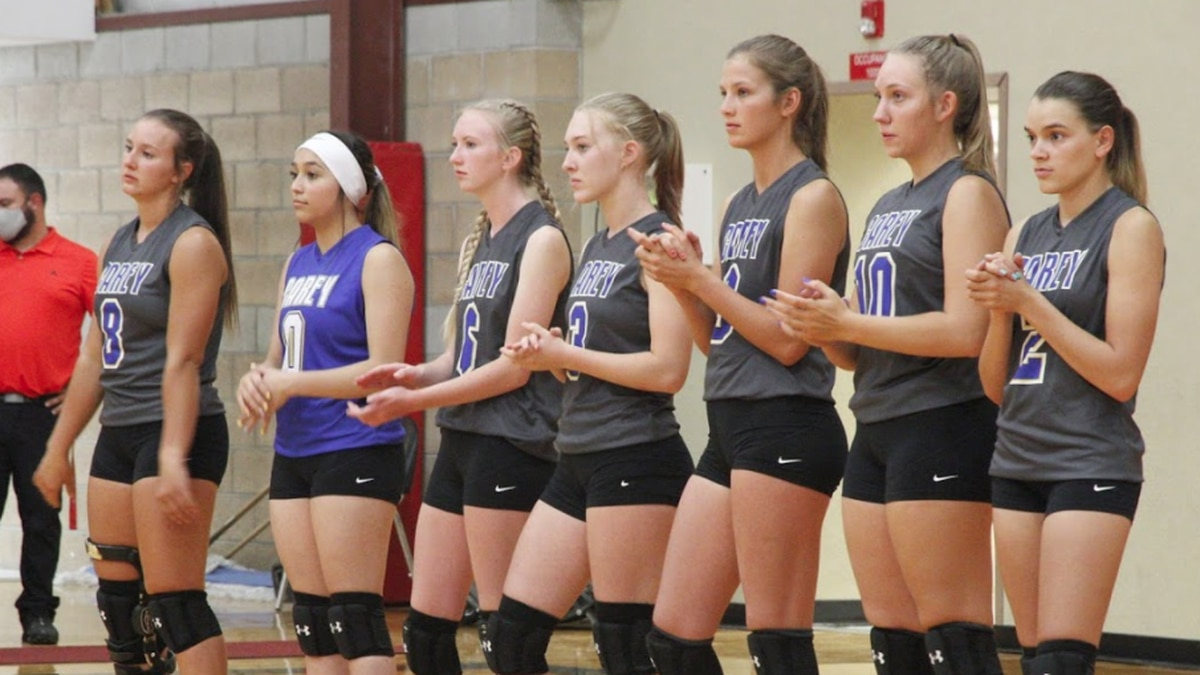 The Carey volleyball team waits for the start of their match.