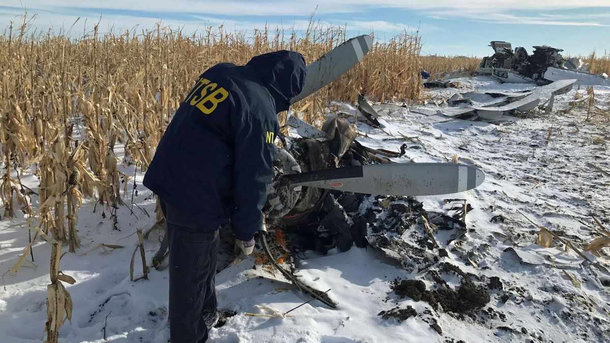 In this photo, taken Monday in Chamberlain, South Dakota, an National Transportation Safety Board air safety investigator begins the initial examination of the wreckage of the Pilatus PC-12 that crashed on Nov. 30, 2019, at 12:30 p.m. CT shortly after departure from Chamberlain Municipal Airport. (Source; NTSB).