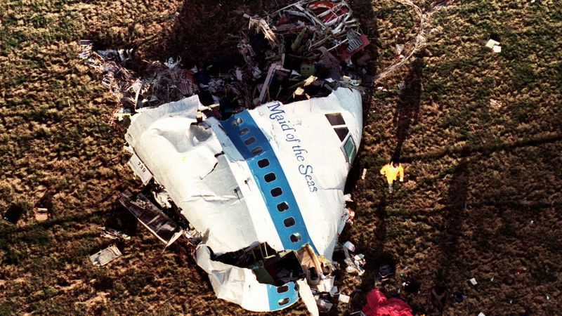 In this Dec. 22, 1988, file photo police and investigators look at what remains of the nose of...