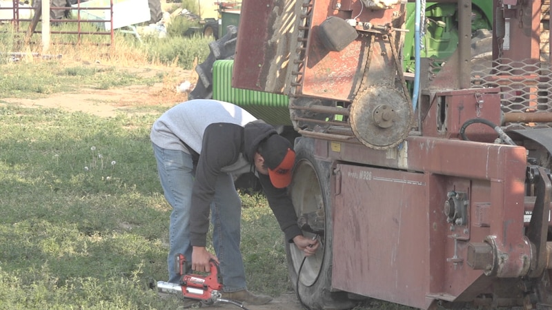 High school senior Tregan Zollinger working on his family's farm in Burley.