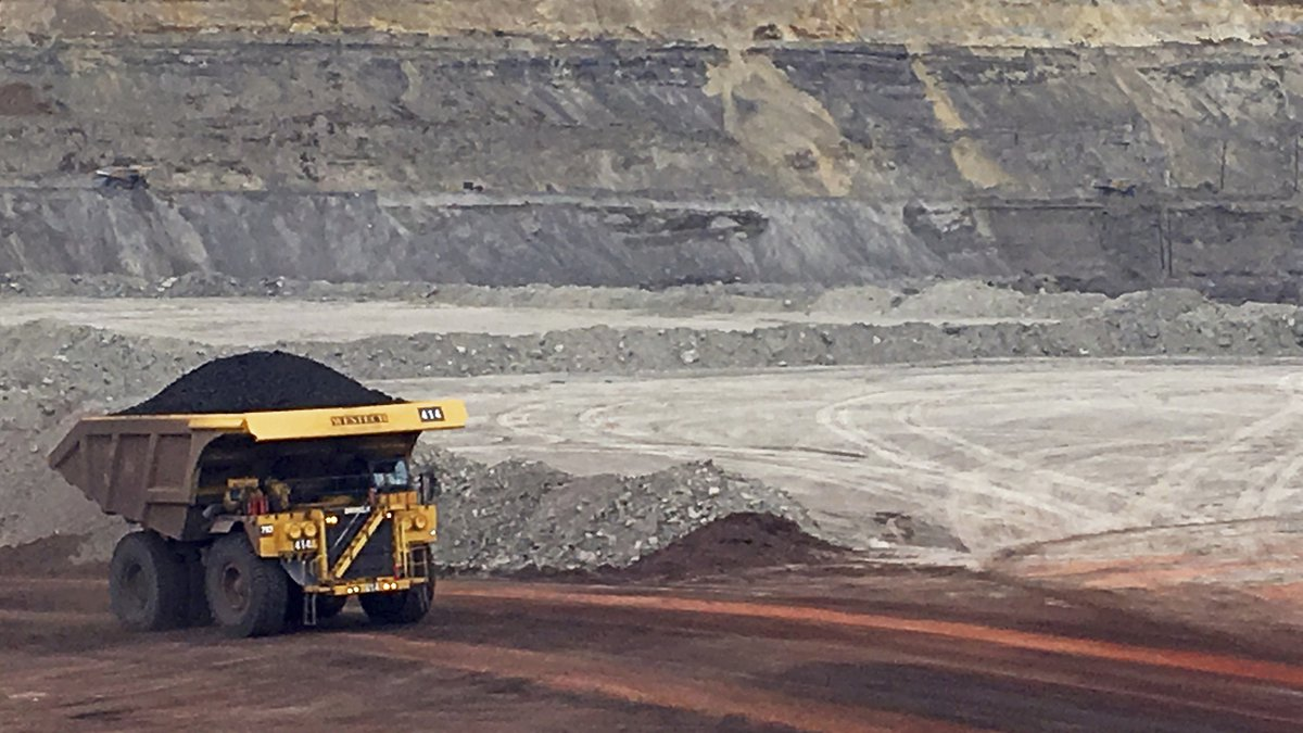 FILE - In this March 28, 2017, file photo, a dump truck hauls coal at Contura Energy's Eagle...