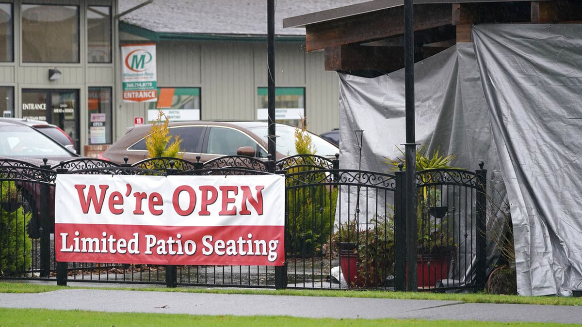 FILE — A sign at the El Sarape restaurant advertises outdoor seating, Tuesday, Jan. 5, 2021, in...