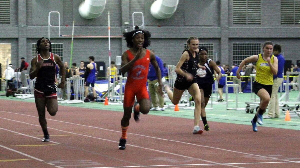 FILE - In this Feb. 7, 2019, file photo, Bloomfield High School transgender athlete Terry Miller, second from left, wins the final of the 55-meter dash over transgender athlete Andraya Yearwood, far left, and other runners in the Connecticut girls Class S indoor track meet at Hillhouse High School in New Haven, Conn. Miller and Yearwood are among Connecticut transgender athletes who would be blocked from participating in girls sports under a federal lawsuit filed Wednesday, Feb. 12, 2020, by the families of three athletes. (AP Photo/Pat Eaton-Robb, File)