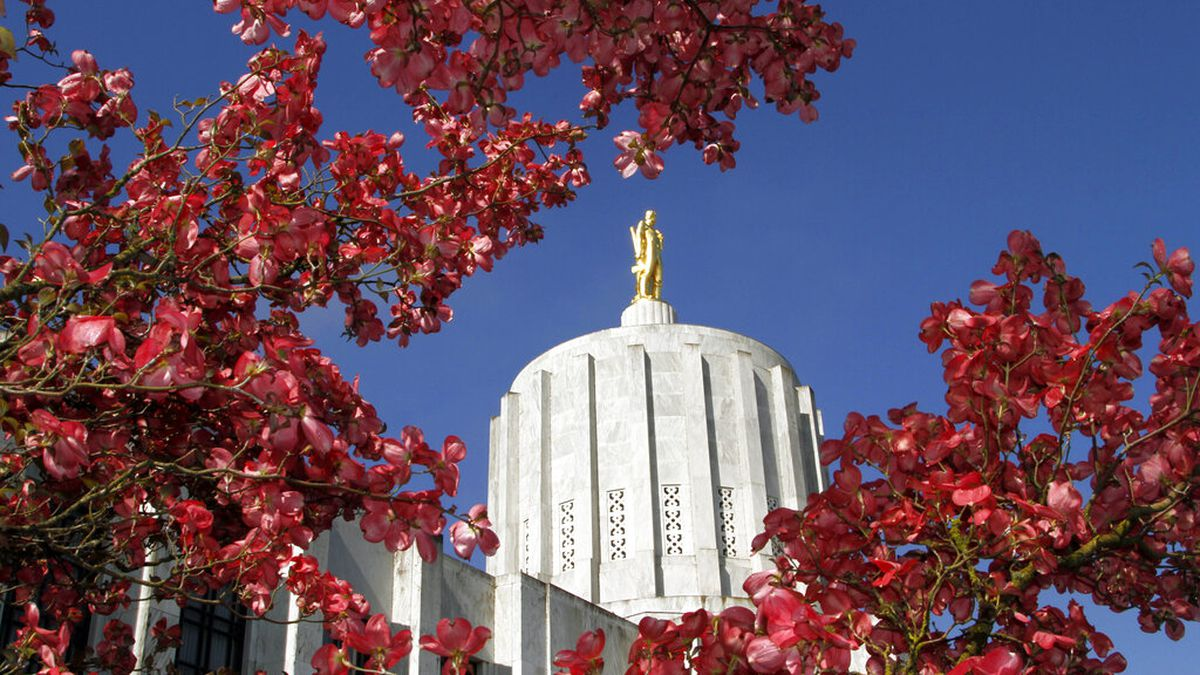FILE - In this May 12, 2011, file photo, the Oregon Capitol is shown surrounded by spring...