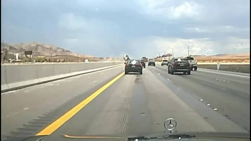 A Nevada driver hydroplaned and flipped a vehicle over an interstate median.