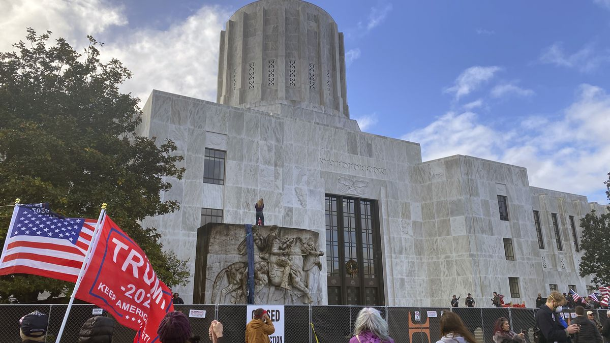 FILE - In this Dec. 21, 2020, file photo, protesters hold a rally outside the Oregon State...