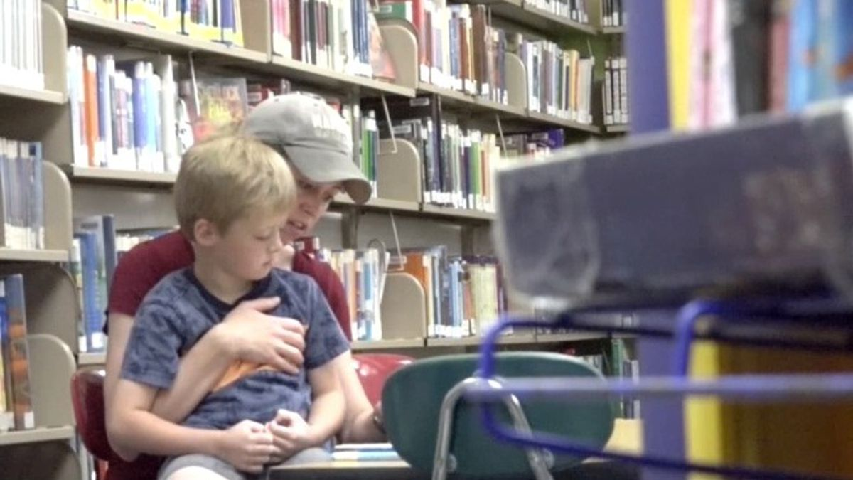 Stephanie Christensen reads to her son at the Burley Library on Tuesday.