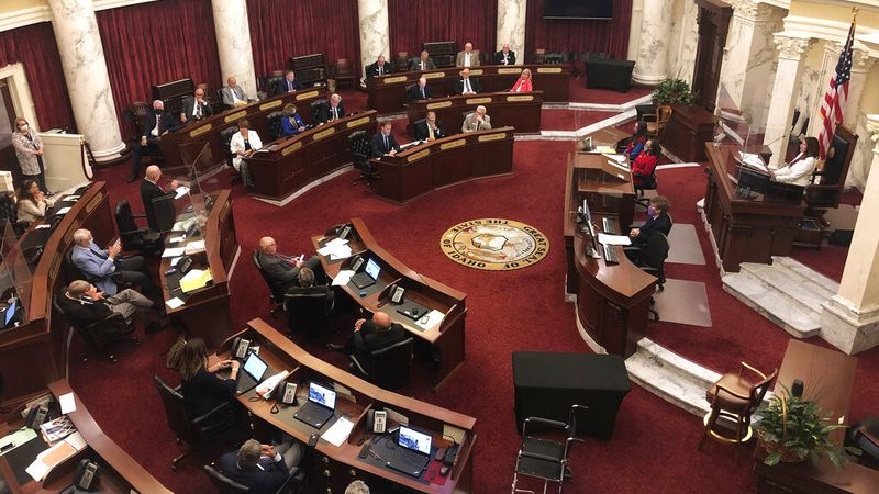FILE - In this Aug. 26, 2020, file photo, the Idaho Senate debates a bill, at the Statehouse in...