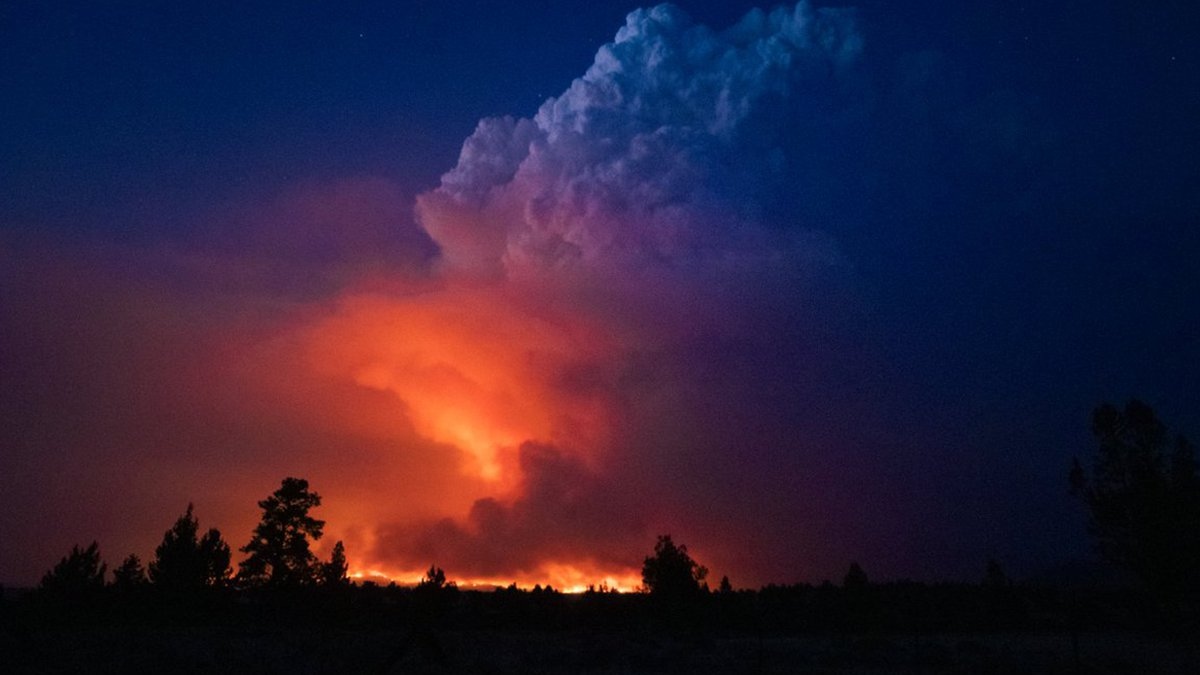 In this photo provided by the Oregon Office of State Fire Marshall, flames and smoke rise from...